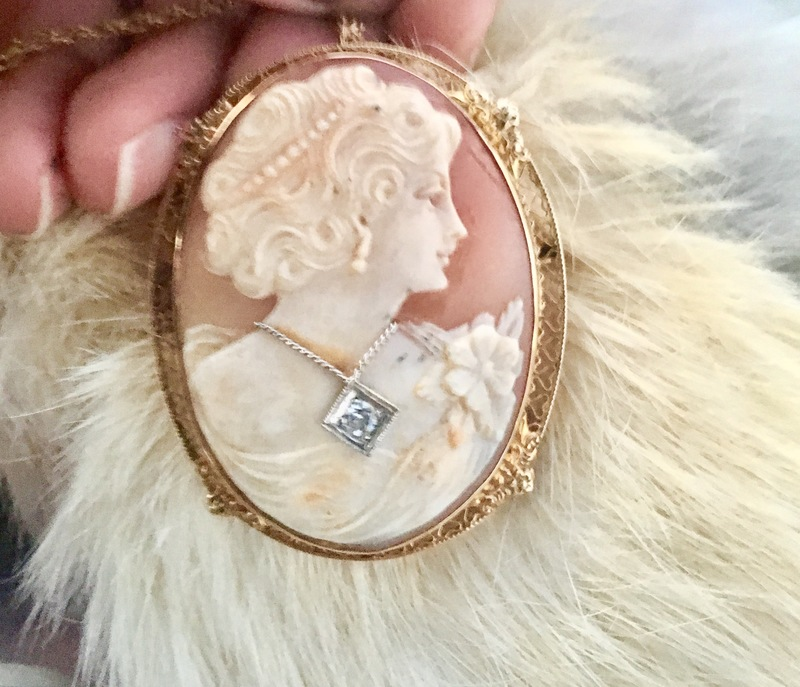 Gold oval shaped broach,designs on...