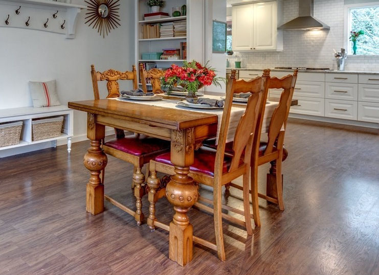 Breugel table, chairs, and liquor cabinet