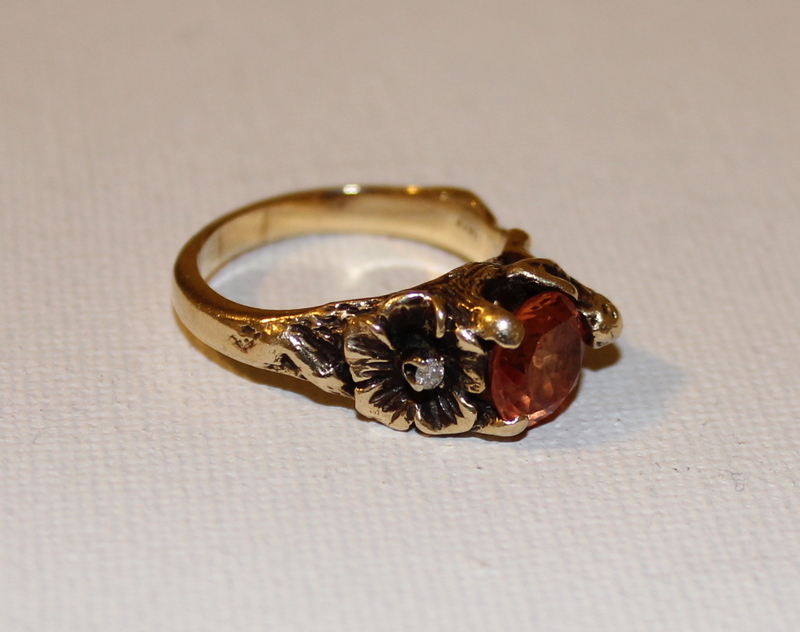 Strell 14 KT gold ring with gem stone