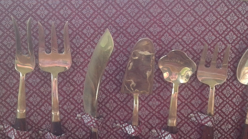 Siam teak and ? (brass/gold) cutlery set value